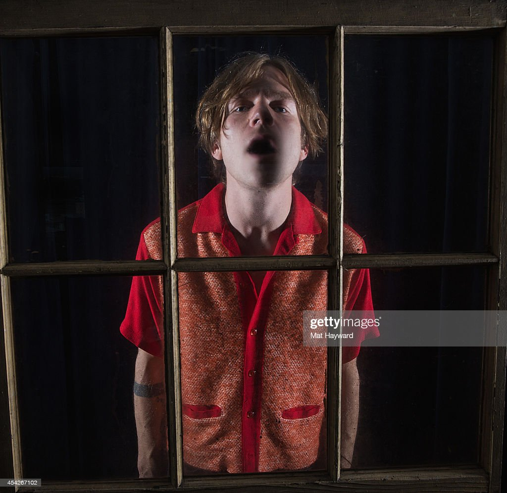 Singer Matt Shultz of Cage the Elephant poses for a portrait behind a window after performing an EndSession hosted by 107.7 The End at the KNDD station on August 27, 2014 in Seattle, Washington.