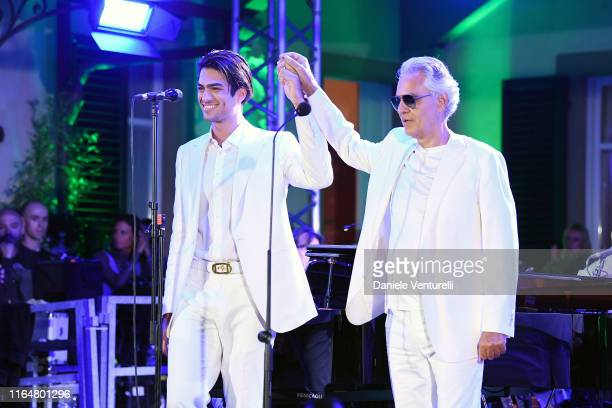 Singer Matteo Bocelli and Andrea Bocelli performs on stage during the the Andrea Bocelli Celebrity Fight Night 2019 on July 28, 2019 in Forte dei...
