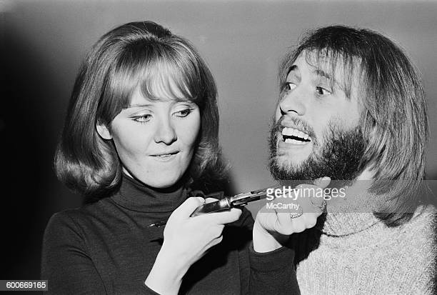 Singer Maurice Gibb of the Bee Gees has his beard shaved off by his wife Scottish pop singer Lulu UK 1st February 1970 He is about to appear in the...