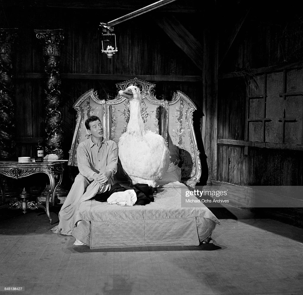 Singer Max Bygraves and his singing comic goose performs on the 'Toast of the Town' show hosted by Ed Sullivan at the Maxine Elliott Theater in New York, New York.