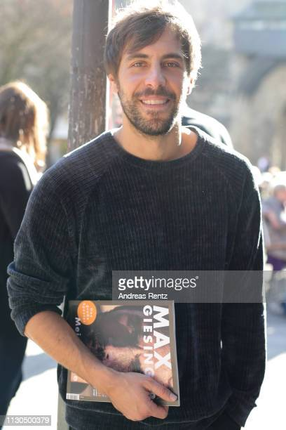 Singer Max Giesinger poses for a photograph during a private concert on the occasion of the launch of his fan magazine Meine Reise on February 18...