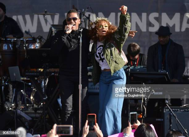 Singer Maxwell and Andra Day onstage during the Women's March Los Angeles 2018 on January 20 2018 in Los Angeles California