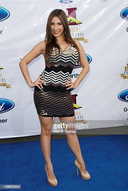 Singer Mayra Veronica walks the blue carpet at the 10th Annual Ford Hoodie Awards at MGM Garden Arena on August 4, 2012 in Las Vegas, Nevada.