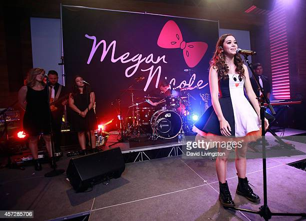 Singer Megan Nicole performs on stage at her album release party for 'Escape' at YouTube Space LA on October 15 2014 in Los Angeles California