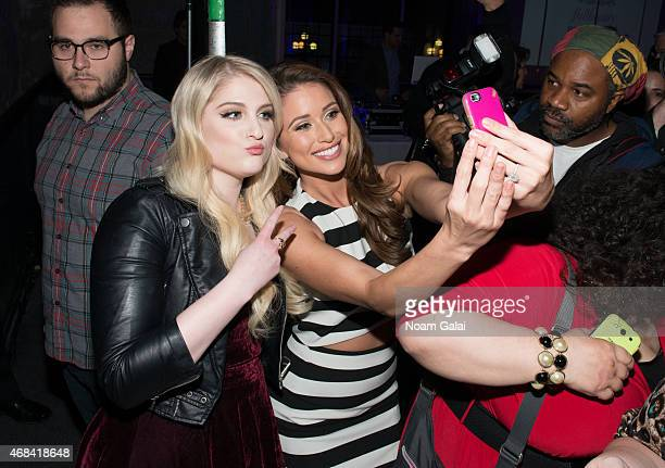 Singer Meghan Trainor and Miss USA Nia Sanchez attend the FULLBEAUTY Brands Launch event at Gustavino's on April 2 2015 in New York City