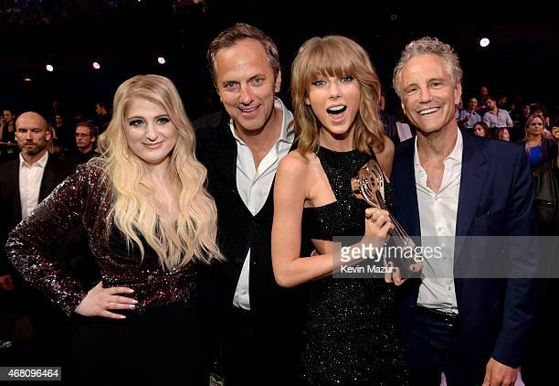 Singer Meghan Trainor President of National Programming Platforms for iHeartMedia Tom Poleman singer Taylor Swift and President of Entertainment...