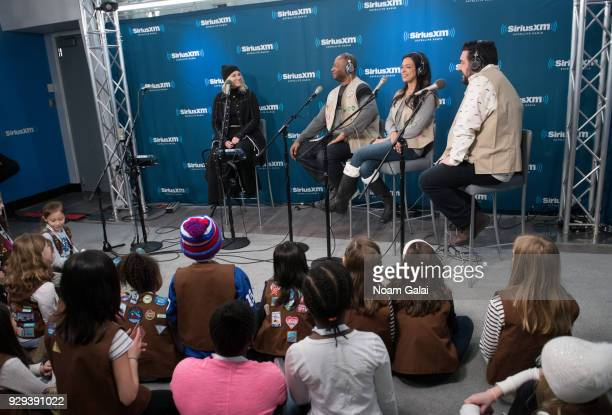 Singer Meghan Trainor speaks with Stanley T Nicole Ryan and Ryan Sampson of SiriusXM 'Hits 1' at SiriusXM Studios on March 8 2018 in New York City