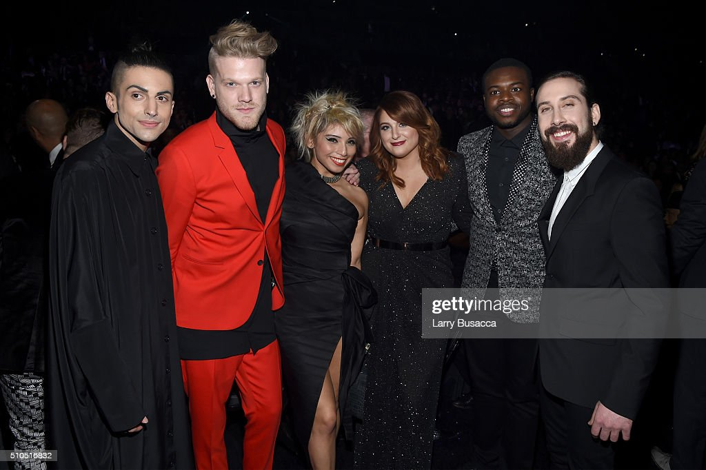Singer Meghan Trainor (3rd from R), with (L-R) singers Mitch Grassi, Scott Hoying, Kirstin Maldonado, Kevin Olusola and Avi Kaplan of Pentatonix, attends The 58th GRAMMY Awards at Staples Center on February 15, 2016 in Los Angeles, California.