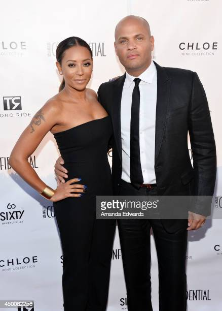 Singer Mel B and her husband Stephen Belafonte arrive at the Los Angeles Confidential Magazine and cover star Robin Wright celebration of the...