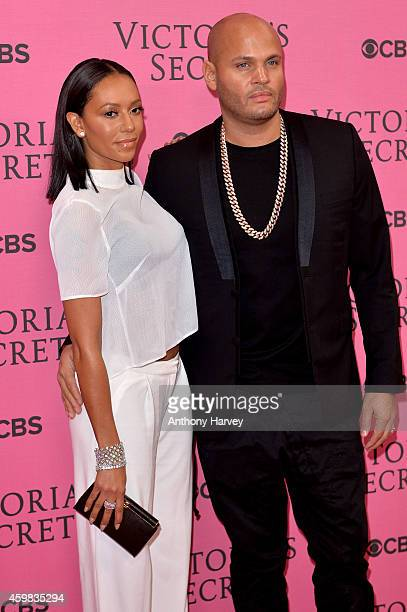 Singer Melanie Brown and husband Stephen Belafonte attend the pink carpet of the 2014 Victoria's Secret Fashion Show on December 2 2014 in London...