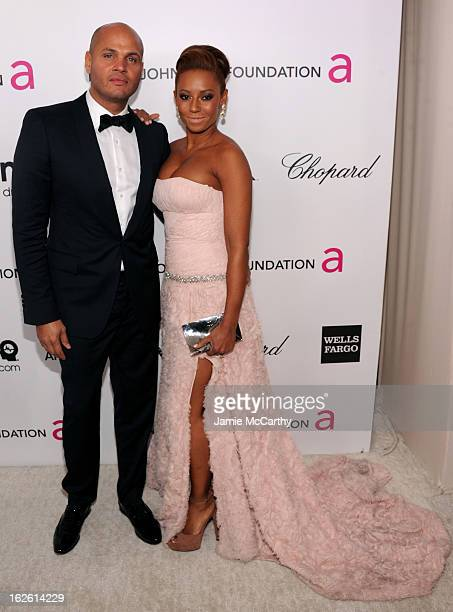 Singer Melanie Brown and Stephen Belafonte attend the 21st Annual Elton John AIDS Foundation Academy Awards Viewing Party at West Hollywood Park on...