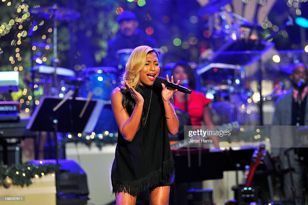 Singer Melanie Fiona performs arrives at A Hollywood Christmas Celebration at The Grove on November 11, 2012 in Los Angeles, California.