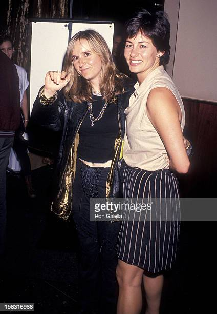 Singer Melissa Etheridge and girlfriend Julie Cypher attend The Beat Goes On Concert to Benefit LIFEbeat After Party on June 24 1994 at Metronome in...