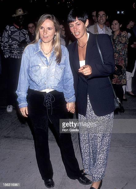 Singer Melissa Etheridge and girlfriend Julie Cypher attend the Twenty Bucks Santa Monica Premiere on October 20 1993 at the Mann Criterion Theatre...