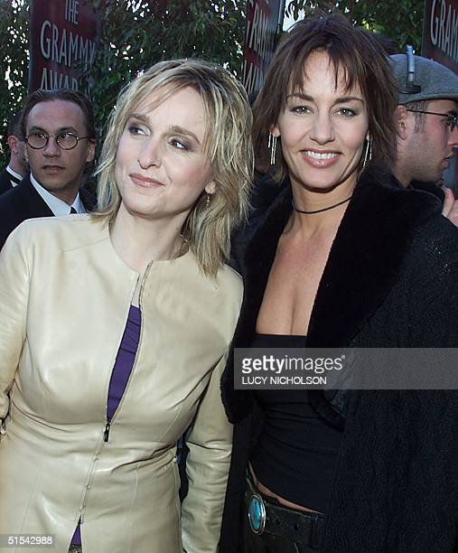 Singer Melissa Etheridge with partner Julie Cypher arrive at the 42nd Grammy Awards Ceremony in Los Angeles CA 23 February 2000 AFP PHOTO/Lucy...
