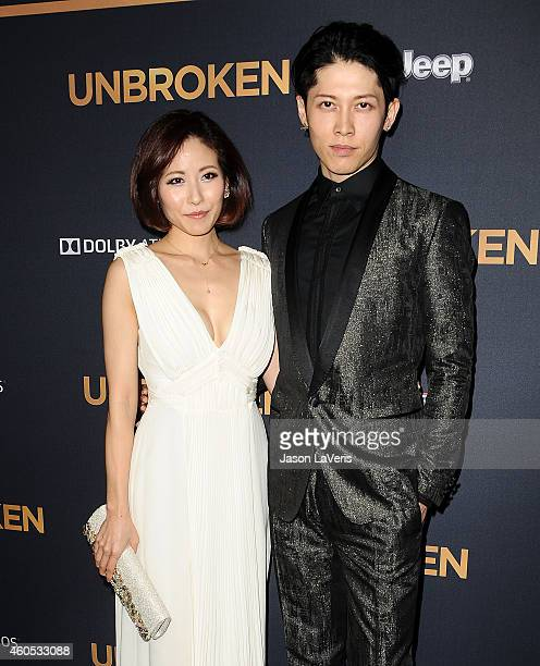 Singer Melody and actor Miyavi attend the premiere of 'Unbroken' at TCL Chinese Theatre IMAX on December 15 2014 in Hollywood California