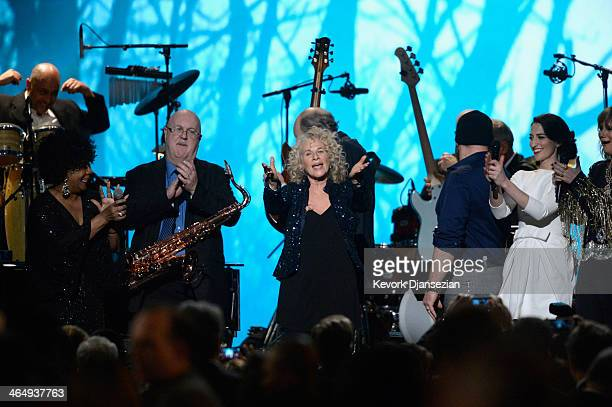 Singer Merry Clayton musician Tom Scott honoree Carole King and musicians Zac Brown and Sara Bareilles perform onstage at The 2014 MusiCares Person...