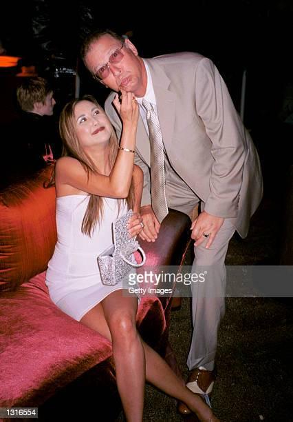 "Singer Miari puts lipstick on husband Tom Jacobson at the ""Lara Croft Tomb Raider"" post premiere party June 11, 2001 in Westwood, CA."