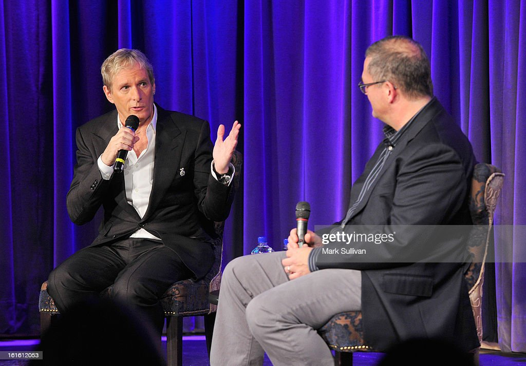 Singer Michael Bolton (L) and Billboard Magazine senior correspondent Phil Gallo onstage during An Evening With Michael Bolton at The GRAMMY Museum on February 12, 2013 in Los Angeles, California.