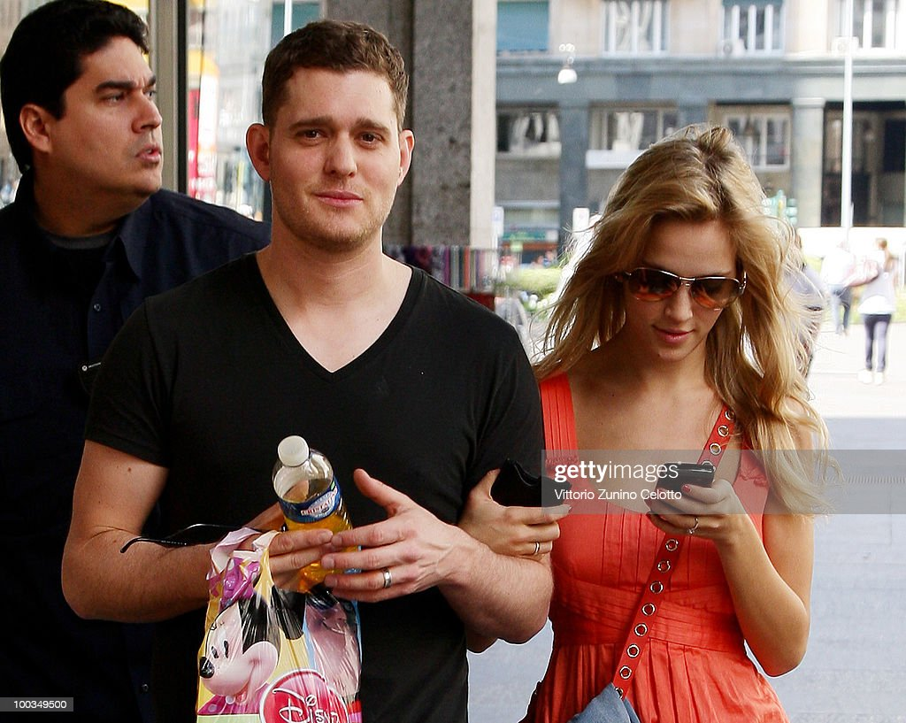 COVERAGE** Singer Michael Buble (C) and girlfriend Luisana Lopilato (R) are seen on May 23, 2010 in Milan, Italy.