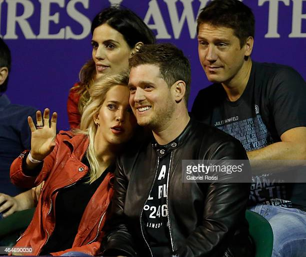 Singer Michael Buble and his wife Luisana Lopilato look the singles match between Rafael Nadal of Spain and Federico Delbonis of Argentina as part of...