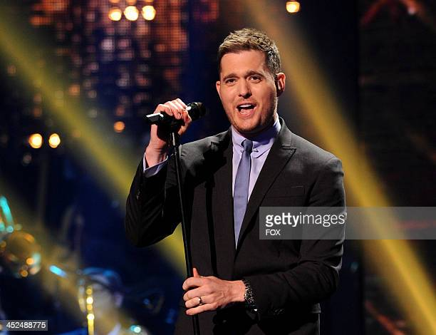 Singer Michael Buble performs on FOX's The X Factor Season 3 Top 8 To 6 Live Elimination Show on November 28 2013 in Hollywood California