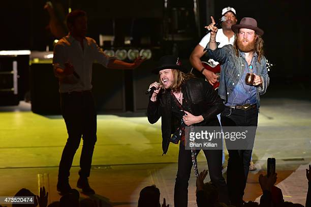 Singer Michael Hobby of the group A Thousand Horses joins Darius Rucker and John Osborne of The Brothers Osborne onstage at PNC Bank Arts Center on...