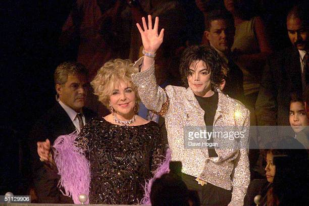 Singer Michael Jackson and actress Elizabeth Taylor arrive at his 30th anniversary celebration on 10th September 2001 in Madison Square Garden in New...