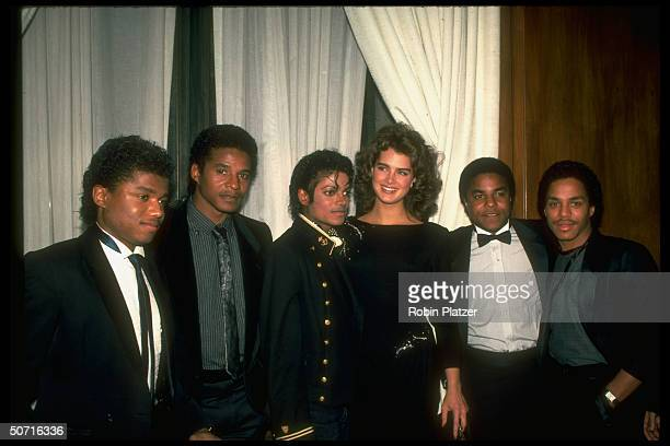 Singer Michael Jackson and his brother with actress Brooke Shields
