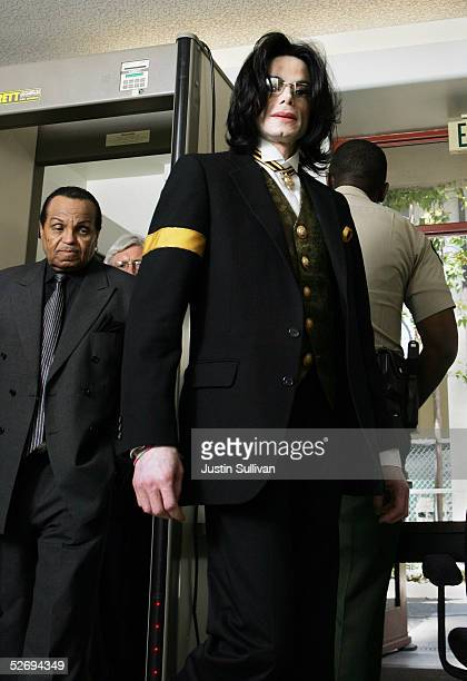 Singer Michael Jackson and his father Joe Jackson pass through a security checkpoint as they return to the courtroom at the Santa Barbara County...