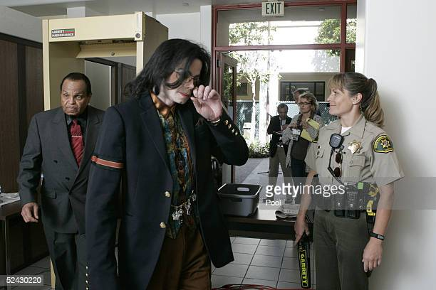 Singer Michael Jackson and his father Joe Jackson return to the courtroom after a break in testimony in the Michael Jackson child molestation trial...