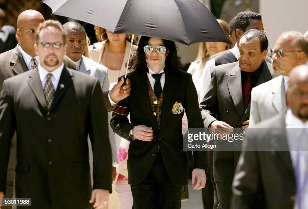 Singer Michael Jackson and his father Joseph Jackson depart the courthouse after listening to closing arguements in his child molestation trial at...