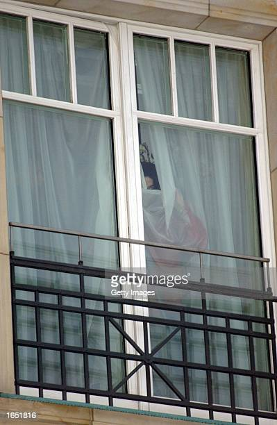 Singer Michael Jackson appears at the balcony of the Adlon Hotel November 19 2002 in Berlin Germany Jackson is in Berlin with his three children to...