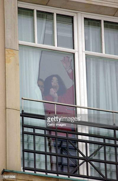 Singer Michael Jackson appears at the balcony of the Adlon Hotel November 19, 2002 in Berlin, Germany. Jackson is in Berlin with his three children...