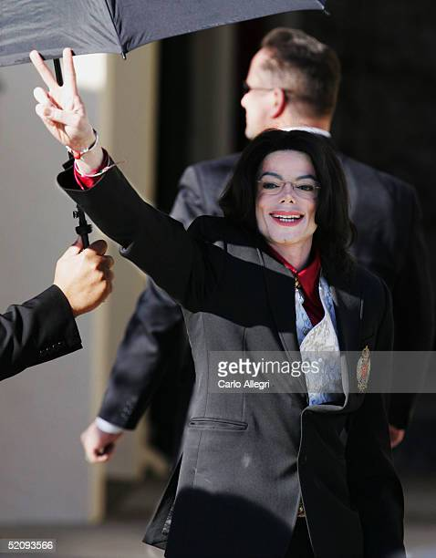 Singer Michael Jackson arrives for the second day of jury selection in his trial on 9 counts of child molestation February 1 2004 in Santa Maria...