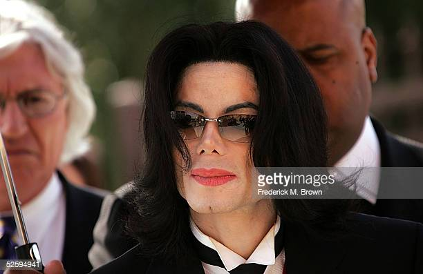 Singer Michael Jackson arrives to the funeral services for lawyer Johnnie L Cochran Jr at the West Angeles Cathedral on April 6 2005 in Los Angeles...