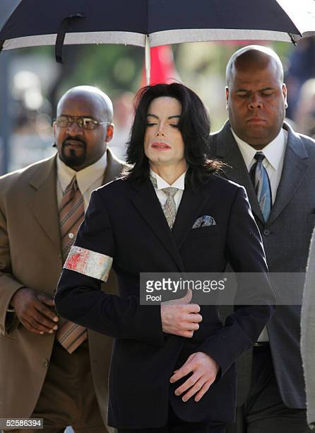 Singer Michael Jackson arrives with his security detail at the Santa Barbara County Courthouse for proceedings in his child molestation trial April 4...