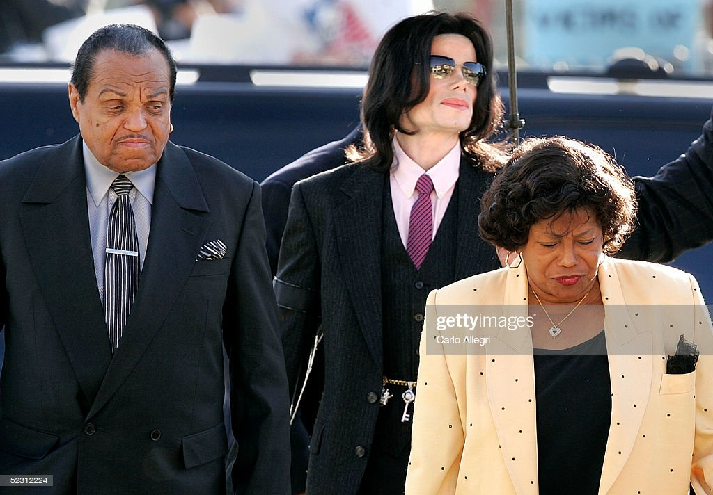 Singer Michael Jackson (C) arrives with parents, Joseph Jackson (L) and Katherine Jackson, at the Santa Maria Superior Court during the second week of the trial March 8, 2005 in Santa Maria, California. Jackson is charged in a 10-count indictment with molesting a boy, plying him with liquor and conspiring to commit child abduction, false imprisonment and extortion. He has pleaded innocent.