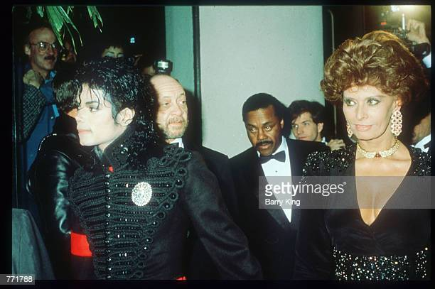 Singer Michael Jackson attends the American Cinema Awards with actress Sophia Loren January 27 1990 in Los Angeles CA Jackson who was the lead singer...