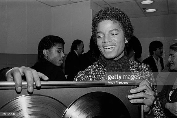 Singer Michael Jackson backstage at Nassau Coliseum receiving a Double Platinum record award for his album 'Off the Wall' New York 1980