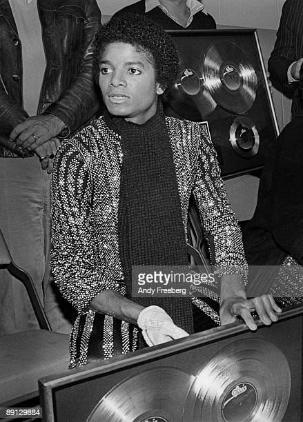 Singer Michael Jackson backstage at Nassau Coliseum receiving Double Platinum record award for his album 'Off the Wall' New York 1980