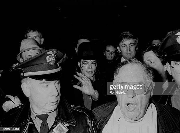 Singer Michael Jackson businessman Donald Trump and public relations agent Lee Solters attend the grand opening of Trump Taj Mahal Casino on April 6...