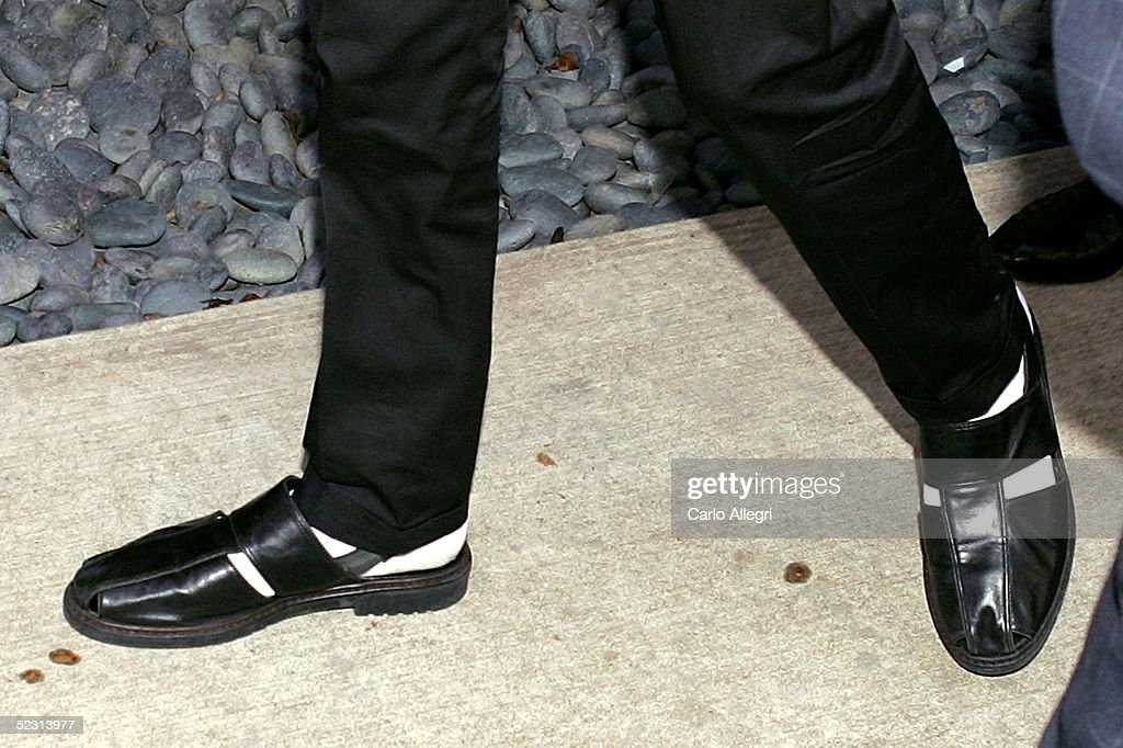 Singer Michael Jackson departs the Santa Maria Superior Court wearing sandals during the second week of the trial March 8, 2005 in Santa Maria, California. Jackson is charged in a 10-count indictment with molesting a boy, plying him with liquor and conspiring to commit child abduction, false imprisonment and extortion. He has pleaded innocent.