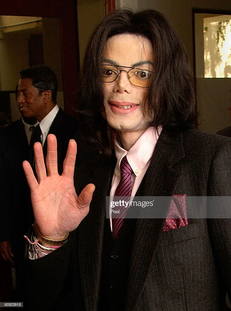 Singer Michael Jackson gestures as he arrives at the Santa Maria Superior Court during the second week of his child molestation trial March 8, 2005 in Santa Maria, California. Jackson is charged in a 10-count indictment with molesting a boy, plying him with liquor and conspiring to commit child abduction, false imprisonment and extortion. He has pleaded innocent.
