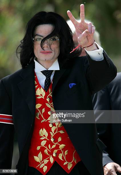 Singer Michael Jackson gestures as he leaves the Santa Barbara County Courthouse after another day of proceedings in his child molestation trial May...