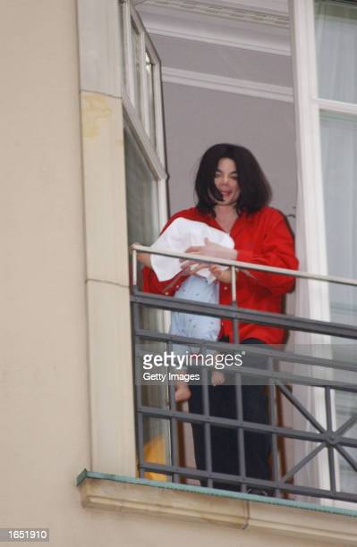Singer Michael Jackson holds his eightmonthold son Prince Michael II on the balcony of the Adlon Hotel November 19 2002 in Berlin Germany Jackson is...