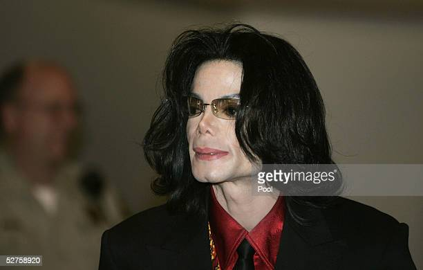 Singer Michael Jackson leaves court at the end of the day's proceedings in his child molestation trial at the Santa Barbara County Courthouse May 4...