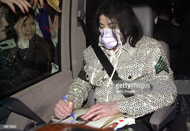 Singer Michael Jackson leaves the Adlon Hotel November 19 2002 in Berlin Jackson is in Berlin with his three children to accept a lifetime...