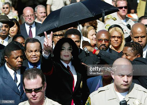 Singer Michael Jackson leaves the courthouse with his father Joe Jackson and his mother Katherine Jackson after his arraignment where he pleaded not...