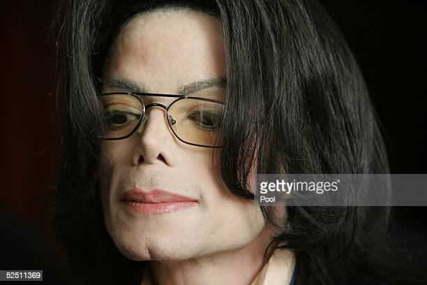 Singer Michael Jackson leaves the courtroom at the Santa Barbara County Courthouse during his child molestation trial March 30 2005 in Santa Maria...
